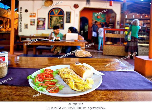 Close-up of a cheese egg roll with salad and bread in a plate, Baba au Rhum Restaurant, Opposite Uttam Resorts, Near Club Cubana, Arpora, Bardez, North Goa, Goa