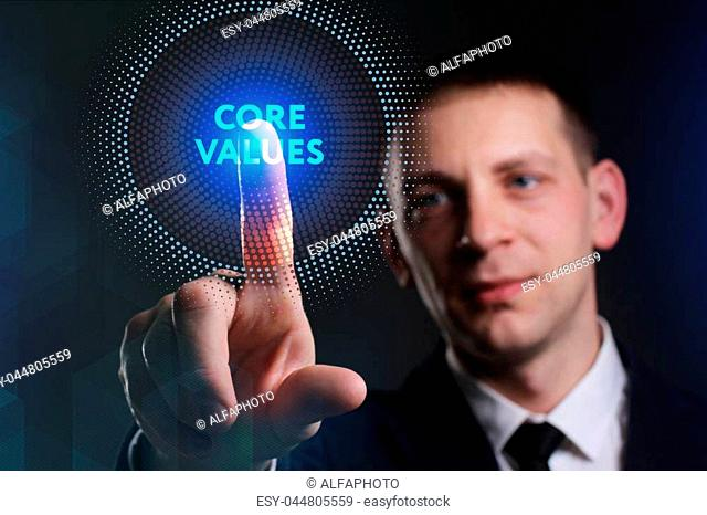 Business, Technology, Internet and network concept. Young businessman working on a virtual screen of the future and sees the inscription: Core values