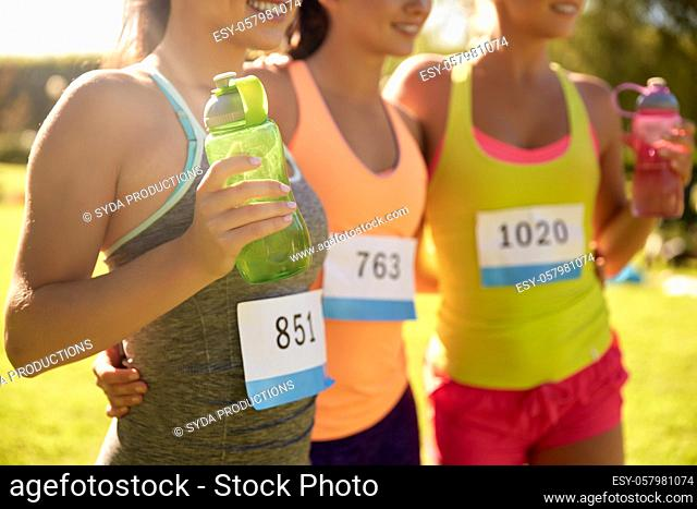 happy young sporty women with racing badge numbers