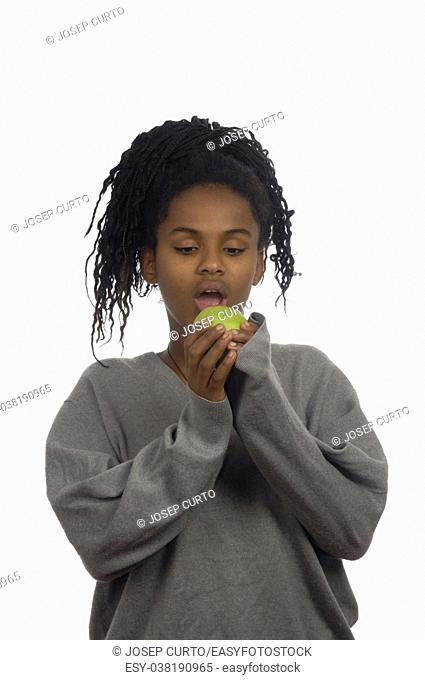 Teenage girl biting an apple
