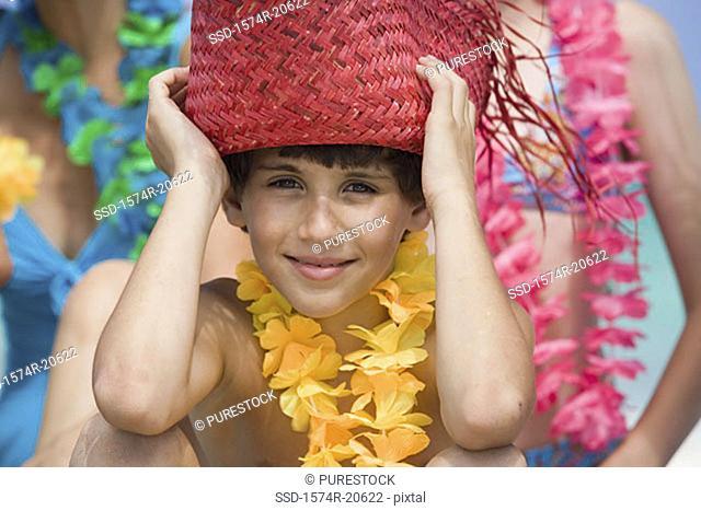 Portrait of a boy wearing a straw hat
