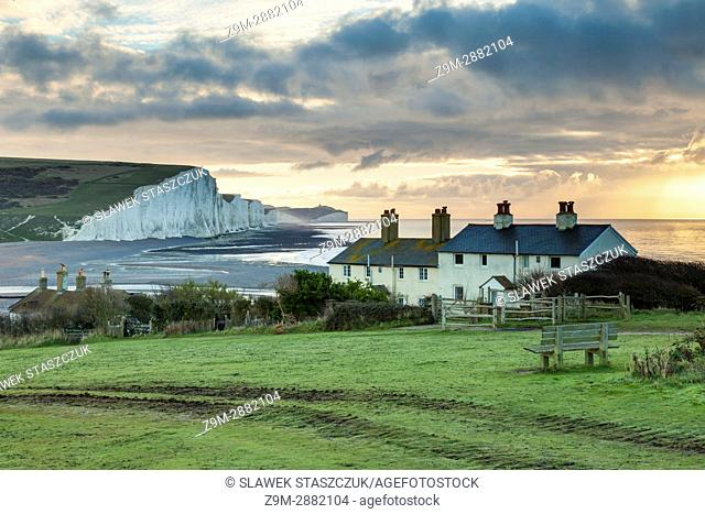 Sunrise at Coastguard Cottages in East Sussex, England. Seven Sisters cliffs in the distance