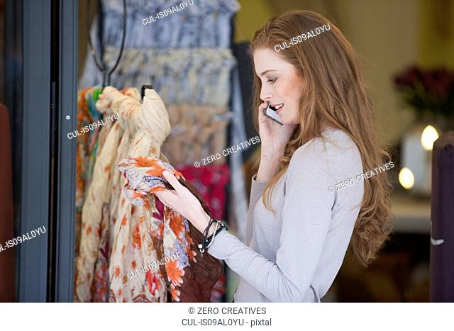 Woman on smartphone shopping for scarf