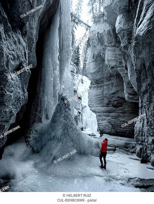 Woman exploring Maligne Canyon, Jasper National Park, Alberta, Canada