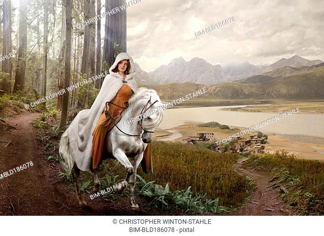 Caucasian woman riding horse in remote forest
