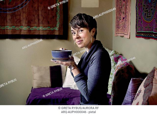 Woman enjoying with cup of tea