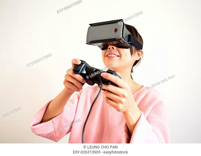 Woman play video game with vr device