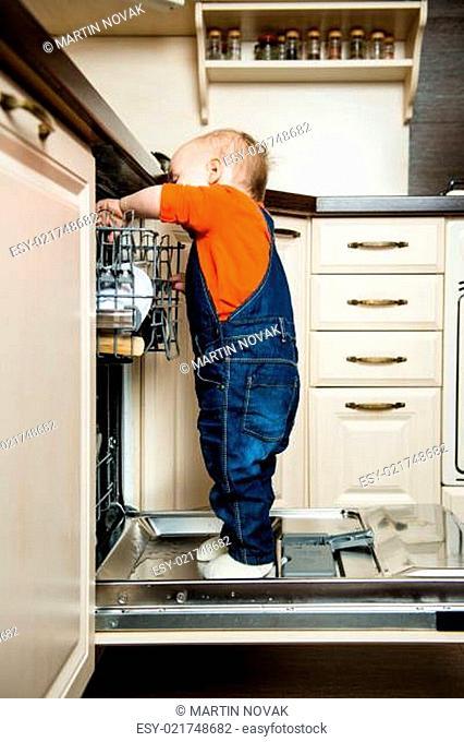 Baby helping unload dishwasher