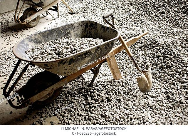 Shovel wheelbarrow and gravel