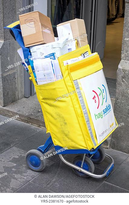 Postal worker delivering mail to shops in calle Triana in Las Palmas, Gran Canaria, Canary Islands, Spain