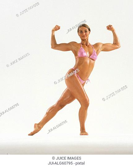 Female bodybuilder flexing biceps in stylized pose