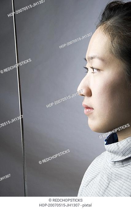 Close-up of a female fencer holding a sword