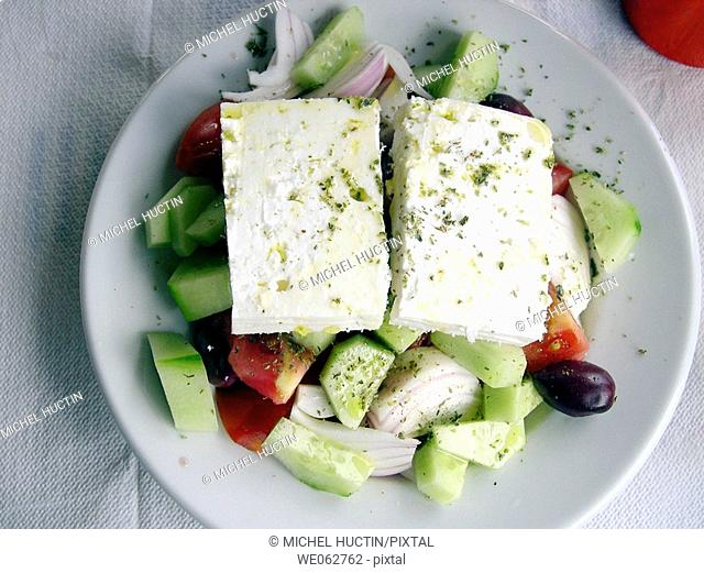 Greek salad with cucumber, tomatoes, onion, olives, peppers and 'feta' cheese