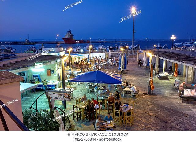 The evening fish market and restaurants by the seaport of Gallipoli, Apulia, Italy