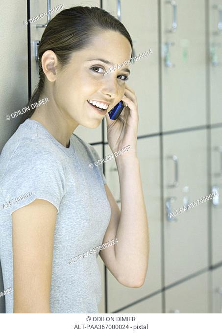 Preteen girl using phone
