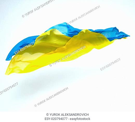 abstract pieces of blue and yellow fabric flying