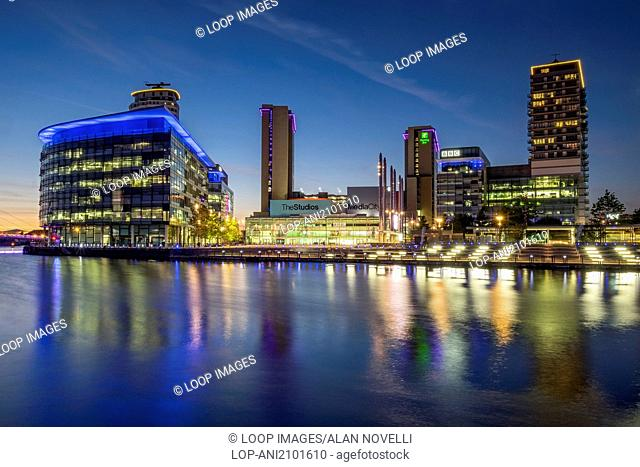 MediacityUK reflected in Salford Quays at twilight
