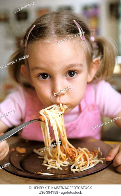 Nursery school. Gir eating spaghetti