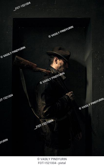 Side view of cowboy standing in niche