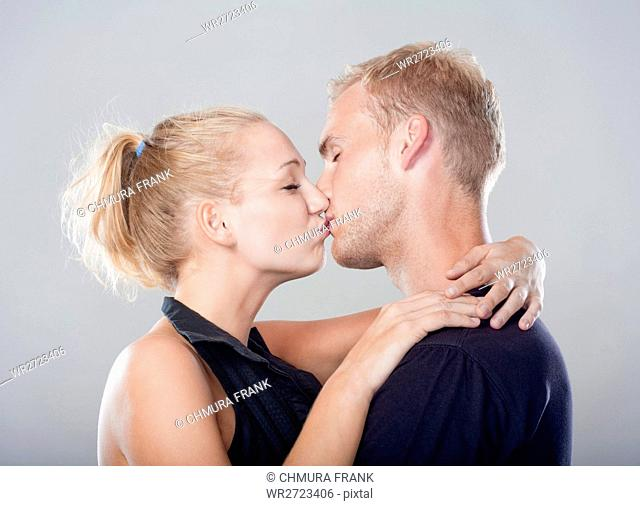 affectionate, attractive, beautiful, beauty, blond, boyfriend, casual, Caucasian, cheerful, couple, embrace, embracing, female, girl, girlfriend, handsome