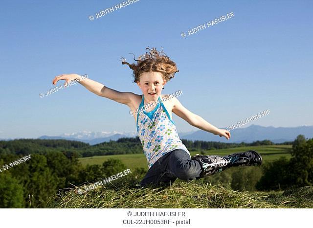Girl jumping in grass