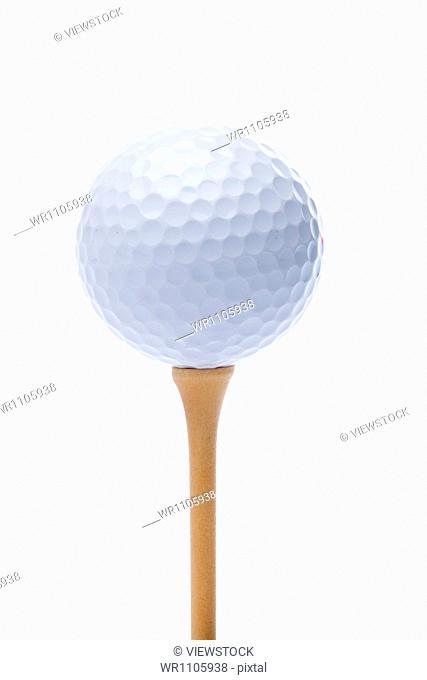 Golf tee and ball