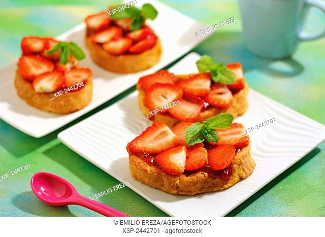 Torrijas with strawberries. Typical Spanish meal