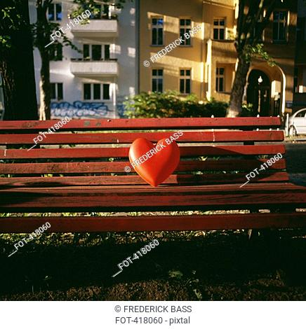 Red heart on an empty bench