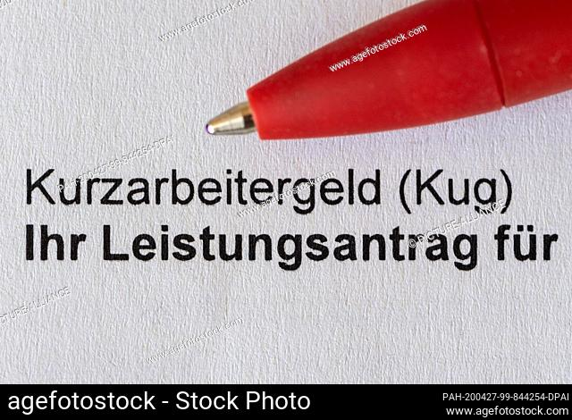26 April 2020, Saxony, Dresden: A red pencil is placed on an application for short-time work allowance (Kug) from the Federal Employment Agency