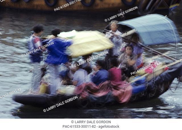 Hong Kong, Sai Kung, Fishing Village, Local people in boat, Blurred action