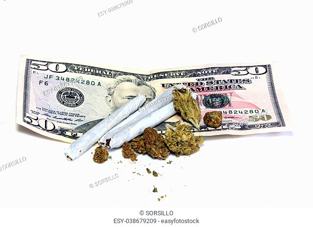 A 50 dollar US bill is shown under a cluster of marijuana pot buds and three joints, over white