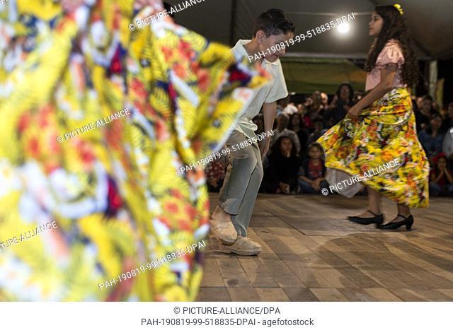 18 August 2019, Brazil, Paranagua: Children dance at the celebration of the Holy Spirit during the Fandango festival in Paranagua