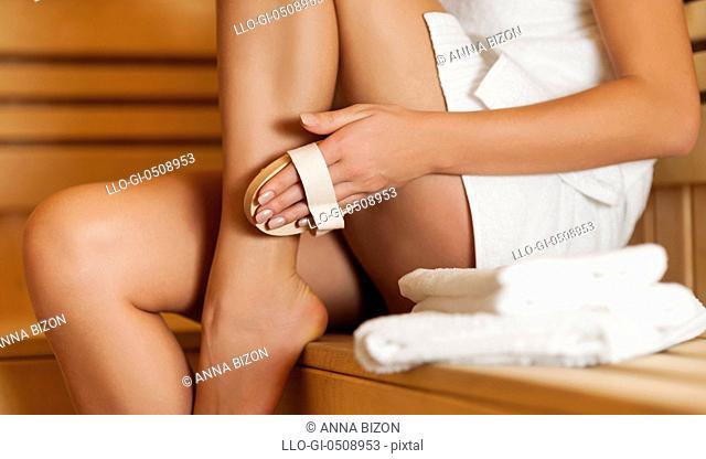 Woman massaging leg in sauna Debica, Poland
