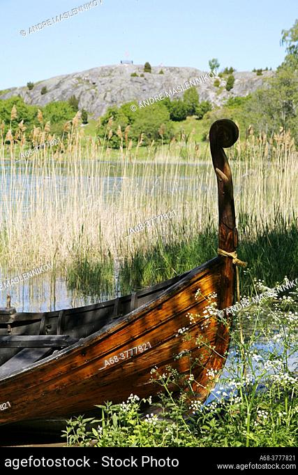 Replica of a boat from Viking times by the beach at the world heritage Birka on Björkö in Lake Mälaren