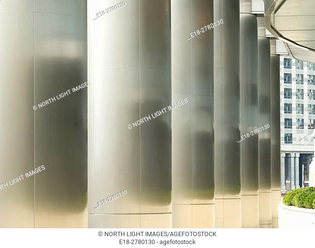 USA, IL, Chicago. Stainless steel pillars along side a walkway beside the Trump Tower and the Chicago River