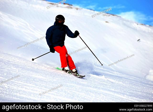 Sporty skier riding the slope