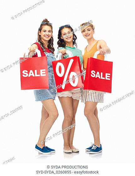 female friends with red shopping bags on sale