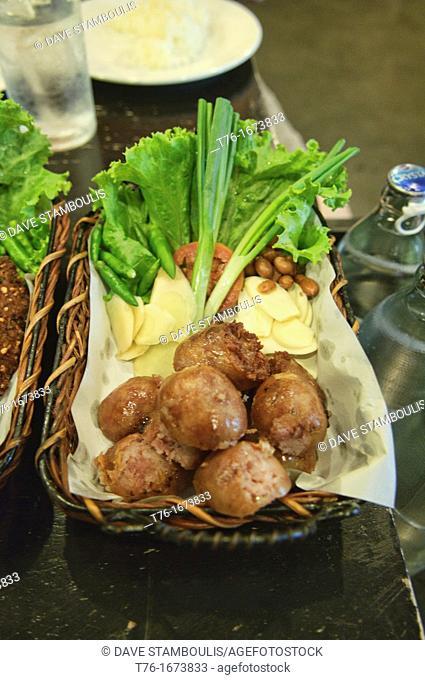 Isaan pork sausage at a restaurant in Bangkok, Thailand