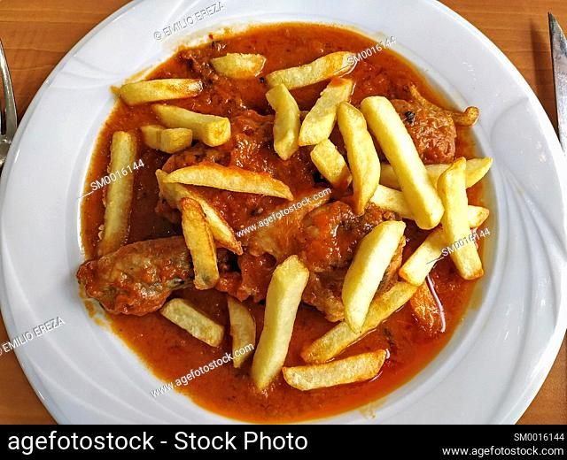 Chicken legs with tomato sauce and potatoes