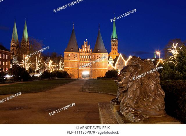 The Holsten Gate / Holstein Tor / Holstentor at Christmas in the Hanseatic City of Lübeck, Germany
