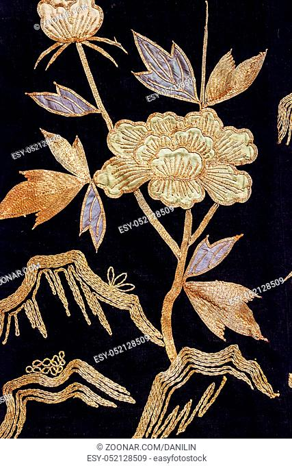 Vintage traditional japanese silk kimono Japan gold flowers pattern on decorative background