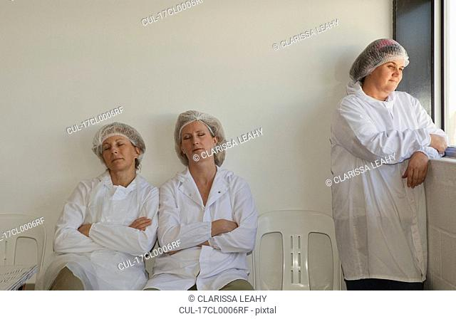Factory workers resting