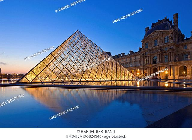 France, Paris, area listed as World Heritage by UNESCO, Louvre Museum, the Louvre pyramid by architect Ming Pei and the facade of the pavilion Richelieu