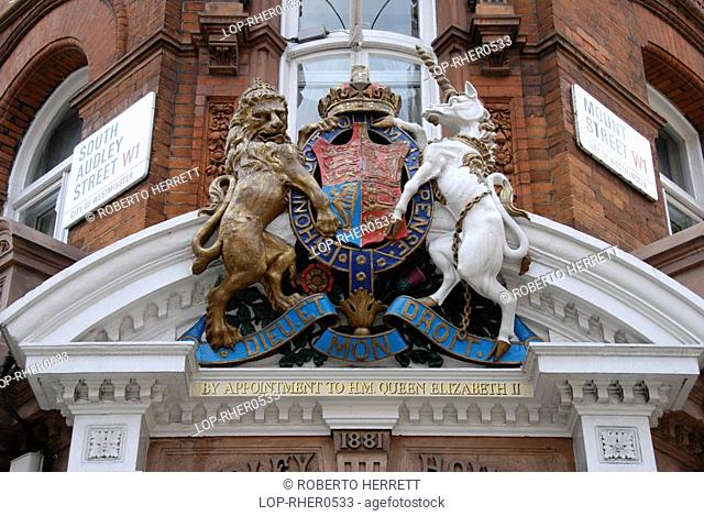 England, London, Mayfair, By Appointment to her Majesty the Queen crest above shop