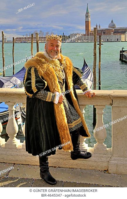 Man in historical Renaissance costume at the lagoon, island of San Giorgio, carnival in Venice, Italy