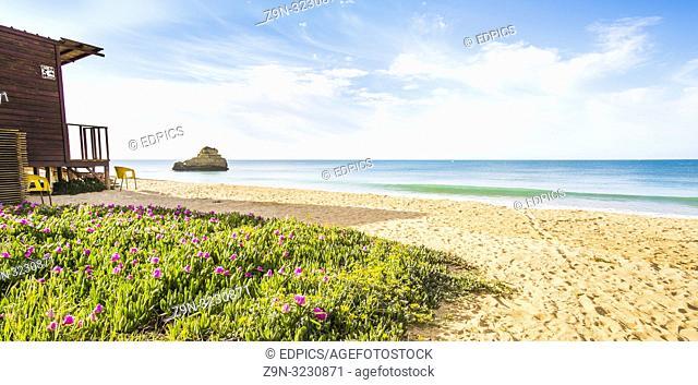 wooden beach hut on deserted beach, praia da rocha, portimao, algarve, portugal