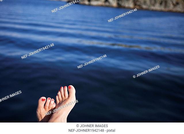 Human feet, sea in background, Bohuslan, Sweden