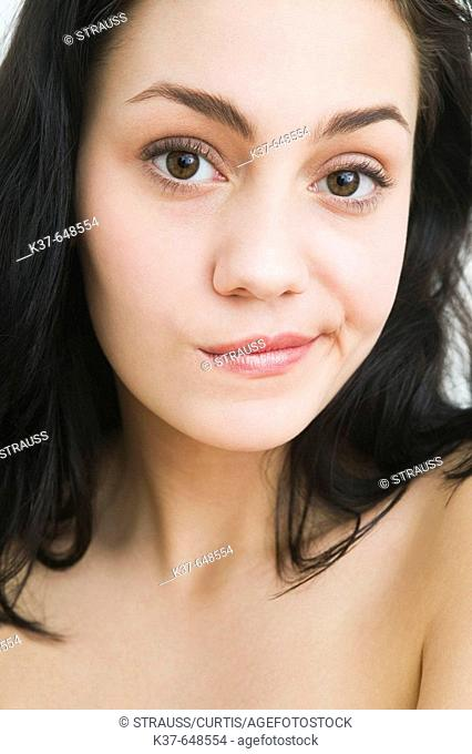 Young woman looking regretful, apprehensive, considering her options