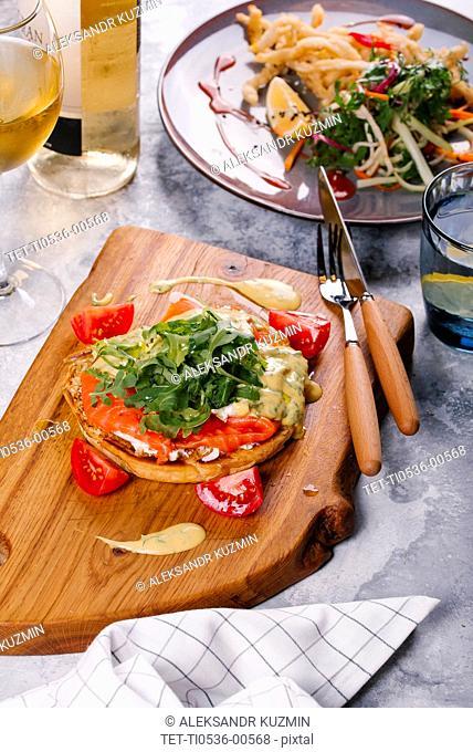 Salmon on bread with arugula
