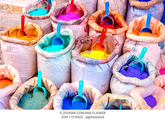 Colorful dry dyes and pigments powders in bags